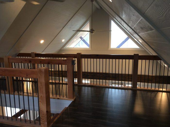 Loft Space - LVP Flooring - wood look flooring - Custom Railing